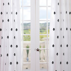 Mirror Eggshell Embroidered Faux Silk Curtain - Mirror Eggshell Embroidered Faux Silk Curtain is an eggshell background with black embroidery. Defined by a unique sheen and fine weave, our Exclusive Poly Taffeta Curtains & Drapes are gorgeous and timeless. Our Taffeta drapes have a crisp smooth finish in contrasting embroidery patterns. The Poly Taffeta fabric provides you with a quality, cost saving alternative.