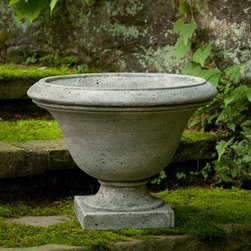 Campania International Moreland Cast Stone Urn Planter - About Campania InternationalEstablished in 1984, Campania International's reputation has been built on quality original products and service. Originally selling terra cotta planters, Campania soon began to research and develop the design and manufacture of cast stone garden planters and ornaments. Campania is also an importer and wholesaler of garden products, including polyethylene, terra cotta, glazed pottery, cast iron, and fiberglass planters as well as classic garden structures, fountains, and cast resin statuary.Campania Cast Stone: The ProcessThe creation of Campania's cast stone pieces begins and ends by hand. From the creation of an original design, making of a mold, pouring the cast stone, application of the patina to the final packing of an order, the process is both technical and artistic. As many as 30 pairs of hands are involved in the creation of each Campania piece in a labor intensive 15 step process.The process begins either with the creation of an original copyrighted design by Campania's artisans or an antique original. Antique originals will often require some restoration work, which is also done in-house by expert craftsmen. Campania's mold making department will then begin a multi-step process to create a production mold which will properly replicate the detail and texture of the original piece. Depending on its size and complexity, a mold can take as long as three months to complete. Campania creates in excess of 700 molds per year.After a mold is completed, it is moved to the production area where a team individually hand pours the liquid cast stone mixture into the mold and employs special techniques to remove air bubbles. Campania carefully monitors the PSI of every piece. PSI (pounds per square inch) measures the strength of every piece to ensure durability. The PSI of Campania pieces is currently engineered at approximately 7500 for optimum strength. Each piece is air-dried and the