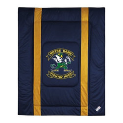 "Sports Coverage - University of Notre Dame Sidelines Comforter - This solid colored jersey mesh comforter is a great way to show support for your favorite team, and it makes the perfect gift for the ultimate fan. Each comforter looks and feels like a real jersey and has the team logo centered on solid team colors. It offers a machine washable design with warm and comfortable polyester fill. Sideline option adds a long mesh line along each side of the logo for a stylish effect. Comforters are available in Twin and Full/Queen sizes. Features: -Notre Dame theme -Screen-printed team graphic -100% polyester jersey mesh -100% polyester fill -5.5 oz. bonded polyester batts -Machine washable -Made in USA -Twin size: 86"" H x 68"" W -Full/Queen size: 86"" H x 86"" W"