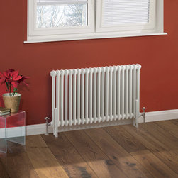 Hudson Reed - Traditional 22 x 2 Column Radiator Cast Iron Style White 23.5 x 39 - This cast iron style radiator, with a high quality white powder coat finish (RAL 9016), has 22 vertical double columns that give a massive heat output of 1,342 Watts (4,576 BTUs) When combined with a set of modern valves, this up-to-date version of a classic radiator design is an ideal complement to contemporary settings, but also fits in well with traditional décor. This versatile radiator is compatible with all domestic central heating systems, will connect with your existing pipe work and is supplied complete with a wall mounting kit. For a truly authentic look, combine this traditional-style radiator with a Hudson Reed floor mounting kit (TRUSH017).  Traditional Column Radiator Cast Iron Style White 23.5 x 39 Details   Dimensions: (H x W x D) 23.5 (660mm) x 39 (990mm) x 2.7 (68mm) Projection When Fitted: 4.5 (115mm) Output: 1,342 Watts (4,576 BTUs) Material: Steel Finish: White Powder Coat (RAL 9016) Columns: 22 x 2 Wall Mounting Brackets Included Please note: Angled Radiator Valves are required, please choose from the options above.  5 Year Guarantee on materials and finish Please Note: Our radiators are designed for forced circulation closed loop systems only. They are not compatible with open loop, gravity hot water or steam systems.