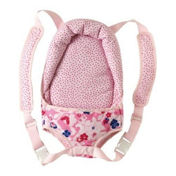 Corolle Mon Classiques Doll Sling - Now your little girl can always carry her baby doll tucked sweetly into the Corolle Mon Classiques Doll Sling. This cute doll sling features adjustable padded straps so it's comfy for your little girl. It has a pink polka dot pattern with coordinating pink and blue flower print that your girl will love. It's designed to fit up to a 17 inch doll.About CorolleCorolle is a premier doll brand designed in the storybook region of France's Loire Valley. Since 1979, Corolle has been creating highly detailed dolls designed to be cherished by children everywhere. Every Corolle doll will inspire magical childhood memories that will last for a lifetime. Corolle dolls look and feel as real as possible. They're created of soft, supple vinyl, have natural-looking hair, and wear on-trend fashions. Corolle dolls are designed durable enough to withstand years of hugs and love. Perfect heirloom treasures! Doll play encourages children to explore different roles from caring for and sharing hopes and dreams to finding an understanding playmate and friend for life. Corolle designs dolls for children of all ages.There is a range of Corolle dolls designed for specific ages. Babi Corolle is a soft-body doll perfect for newborn babies and older. It's machine-washable, feather-light, and made to be loved. Mon Premier Corolle is designed for babies 18 months and older. This line includes a range of baby dolls, clothing, and accessories. The dolls are lightweight and soft. The clothing has Velcro closures so it's easy to put on and take off. Mon Classique Corolle is a classic baby doll designed for toddlers to love and nurture. This line has a complete assortment of larger baby dolls, clothing, and nursery accessories. Some even have hair that can be brushed and styled. Others coo, giggle, drink, and go potty. Mademoiselle Corolle is a toddler doll for toddlers. These dolls have expressive faces, silky long hair, and are dressed in the latest styles. This doll will be your little one's best friend. She's perfect for sharing secrets and working out new hairstyles and fashion. Les Cheries Corolle is designed for little ones four years and older. She has long, lush, rooted hair and an amazing wardrobe of stylish outfits. This doll provides endless hours of fashion and hair play.