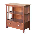 DonnieAnn - Hollydale Chestnut Mission Style Bookcase - This Hollydale piece is a stunning two-shelf bookcase that sits above two very convenient drawers. This chestnut finished bookcase fits books of all shapes and sizes, and the drawers can accommodate your extra commodities.