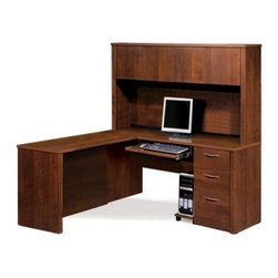 Bestar Embassy L-Shaped Workstation with Single Pedestal - Tuscany Brown - Pack a load of useful workspace into a small space with this Bestar Embassy L-Shaped Workstation with Single Pedestal - Tuscany Brown. This organized workstation kit is full of helpful features including a typing shelf that glides out on smooth ball bearings. The keyboard shelf can be installed under the desk credenza return table or bridge. Two utility drawers sit above a deep file drawer with letter/legal filing system and the bottom two lock with a single key. Four hutch cabinets keep you organized while rubber strips organize wires. The smooth surface is a sturdy one-inch thick for strength with a hard commercial-grade melamine veneer that resists scratches and stains and cleans up with an easy wipe. Medium Tuscany Brown wood-grain finish. It's modular so it can be set up in various configurations and other useful matching components can be added. Meets or exceeds AINSI/BIFMA standards. Assembles easily. Get work done with a sense of organization and privacy.About BestarEstablished in 1948 and based in Canada Bestar is a third-generation family business involved in the design manufacturing and distribution of a wide range of ready-to-assemble furniture and furniture components. Bestar's mission is to create produce and distribute mid- to high-end ready-to-assemble furniture for home offices small commercial offices and home entertainment. Bestar offers a combination of price quality and service that exceeds the expectations of customers and consumers.