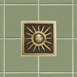"4"" Solid Brass Wall Tile with Sunshine Design - Featuring a whimsical sun design, this charming 4"" accent tile will brighten any kitchen or bathroom.  It is made of solid brass and is offered with an optional tile frame for a custom look."
