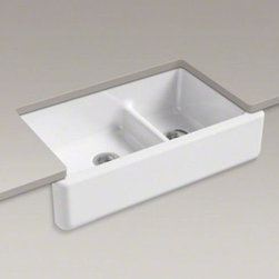 """Kohler - Kohler K-6427-0 White Whitehaven Whitehaven 36"""" Double Basin - Product Features:  Double basin sink with a 60/40 split provides increased versatility for any task. Covered under Kohler's limited lifetime warranty Constructed of enameled cast-iron which combines strength, durability and insulation benefits Undermount installation type provides optimal counter space while giving your kitchen a stylish look Center drain location provides optimal drainage capability All hardware needed for installation included  Product Technologies / Benefits:  Smart Divide:  The basin divider is set to a lower height than perimeter of the sink; you gain the convenience of a single basin sink completely filled, without losing the functionality of a double basin sink. The lower divider also gives more room for working with larger pots and pans providing more access for filling and cleaning. Enameled Cast-Iron:  Kohler Enameled Cast-Iron combines the strength, durability, and insulation benefits of cast-iron with the scratch, chip, and burn resistance of a baked, powder coat finish and comes with an exceptional Lifetime Limited Warranty. When these materials are combined it gives the sink or tub the strength to last a lifetime of use. Kohler Enameled Cast-Iron is also available in a wide variety of specialty colors allowing you to truly customize your home. Self Trimming:  An Apron Front design that overlaps the """"Apron"""" down over a portion of existing cabinetry. This allows the installation of an Apron Front sink with only minor countertop modification.  Product Specifications:  Height: 9-5/8"""" (measured from the bottom of sink to the top of the rim) Overall Width: 21-9/16"""" (measured from the back outer rim to the front outer rim) Overall Length: 35-11/16&rdq"""
