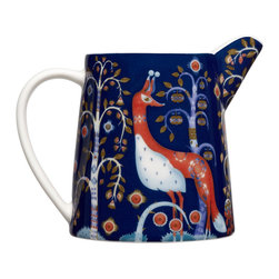 iittala Taika Pitcher 17 oz Blue - Iittala Taika is part of the whimsical Taika series, illustrated by Klaus Haapaniemi for Iittala in 2007. Available in white, blue and black the design draws upon folklore for a fanciful design that is visually stunning. Taika means 'magic' in Finnish and the classic forms designed by Heikki Orvola combine well with other Iittala collections, brings a playful magic to your table.