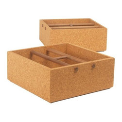Skram Furniture - Corkbox - Square by Skram Furniture - Whether in the garden, the kitchen or the office, the Skram Furniture Corkbox - Square provides you with a naturally stylish way to store and carry your most important items. It features a virtually seamless square of high density cork finished off by a strong walnut bottom and comfortable H-shaped walnut handle. Skram Furniture Company was founded in 2001 by A. Jacob Marks to change the meaning of American craftsmanship by pairing it with contemporary furniture design. The combination of natural materials, sustainable practices and exquisite workmanship have resulted in a versatile modern furniture collection appreciated worldwide. All Skram furniture and home accessories are designed and manufactured in the Piedmont region of North Carolina.