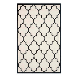 Safavieh - Annette Hand Tufted Rug, Ivory / Black 8' X 10' - Construction Method: Hand Tufted. Country of Origin: India. Care Instructions: Vacuum Regularly To Prevent Dust And Crumbs From Settling Into The Roots Of The Fibers. Avoid Direct And Continuous Exposure To Sunlight. Use Rug Protectors Under The Legs Of Heavy Furniture To Avoid Flattening Piles. Do Not Pull Loose Ends; Clip Them With Scissors To Remove. Turn Carpet Occasionally To Equalize Wear. Remove Spills Immediately. Bring classic style to your bedroom, living room, or home office with a richly-dimensional Safavieh Cambridge Rug. Artfully hand-tufted, these plush wool area rugs are crafted with plush and loop textures to highlight timeless motifs updated for today's homes in fashion colors.