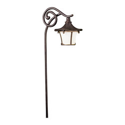 "Kichler 1-Light Landscape Fixture - Aged Bronze - One Light Landscape Fixture From the Cotswold collection, this lighting outdoor path light features a slender curving arm with an elegant scrolling detail and a whimsical looking lantern. The weathered white glass is perfectly complimented by a warm aged bronze finish. Comes with 8"" in-ground stake mounting accessory. Wiring is 28"" of usable #18-2, spt-1-w leads. Cable connector supplied with fixture."