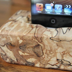 Wrap Wood iPod Docking Station by The Woodlot - I'm a big fan of wooden pieces, especially because metal and plastic are taking over our lives. This gives a touch of warmth where you wouldn't expect.
