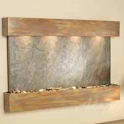 Wall Water Features - The Sunrise Springs Wall Fountain - The Sunrise Springs wall mounted fountain is mysterious and elegant delighting everyone who sets their eyes on it. The Sunrise Springs water wall is hand crafted by the finest artisans in the world. It is sure to light up any home or office. You are able to choose the fountain's face from a variety of materials including slate, lightweight slate, marble, mirror, and travertine. Additionally you can select from three different custom powder coat frame options to give your fountain a truly personalized touch. Furthermore, the frames of the Sunrise Springs interior wall fountain can also be made in a rounded or squared style design. You also have the option to customize your waterfall fountain face by engraving a company logo, design image, loved ones name, birthday, or anniversary.