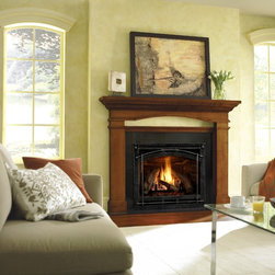 Heat & Glo - Traditional Style - Direct Vent Fireplaces - 6000CLX shown with chateau forge front, portico mantel and absolute black granite..