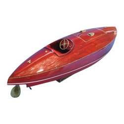 Handcrafted Nautical Decor - Flyer 34'' - --SOLD FULLY ASSEMBLED--Ready for Immediate Display - Not a Model Ship kit --Take to the water in luxury and style with this exquisitely crafted scale-replica model powerboat of the Flyer Speedboat. Known in yachting and speedboat circles as the Ferrari of the boat world, Riva's reputation for speed, beauty and craftsmanship is perfectly mirrored by this museum-quality Flyer powerboat model. --38'' Long x 11'' Wide x 10'' High (1:9 Scale)----    Individual wooden      planks for      hull plank-on-frame construction--    Heartwood Honduran mahogany used for hull construction for real powerboats--    Sturdy wooden      base included      with model--    Limited      production run      only 25 of this speedboat model--    The Flyer model has a dashboard that has realistic gauges/switches, as opposed to stickers--    Sophisticated detailed fittings, trimmings, propellers, steering wheel, horns, etc. Made from stainless steel and brass. No plastic parts--