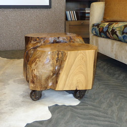 Tree Trunk Coffee Table - Custom tree trunk coffee table with antique casters.