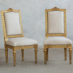 """Eloquence - Eloquence One of a Kind Vintage Side Chair Louis XVI Bright Gilt Set of 2 - The Eloquence One of a Kind collection offers the warmth and character of authentic vintage finds. Intricate and timeless, these Louis XVI-style side chairs make a stunning statement in a living room or dining room. Effortlessly unique, the seats lend a refined aesthetic with a bright gold gilt finish, scallop detailing, a carved garland crest and pale beige rough spun cotton upholstery. Sold as a set of two. Circa 1940. 19""""W x 19""""D x 36""""H. Seat: 17""""H."""