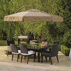 Frontgate - 11-1/2' European Side Mount Patio Umbrella with Valance - German-engineered to turn 360° at the slide of a knob. Built-in shock absorbers at the end of each strut and a vented top help the umbrella withstand windy conditions. Canopy made of Spanish-woven, solution-dyed acrylic. Tieback canopy unzips for off-season storage and spot cleaning. Heavy-gauge powdercoated aluminum frame. The engineering that makes this umbrella swivel and tilt is so extraordinary, it's been patented by the Germans who invented it. Simply turn the knob to rotate the canopy, and slide a lever to angle it against the sun. The awning-grade canopy pivots easily between furniture settings so you can shade a lounging area and a dining area with one umbrella. German-engineered to turn 360 degrees at the slide of a knob . . .  .  . Base is best stabilized with sand (water and sand not included) . Always close umbrella when not in use, or in inclement weather. Minor assembly required; view instructions.
