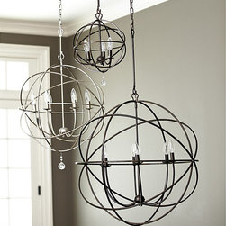 Ballard Designs - Orb Chandelier - Hand finished. UL listed for damp locations. Bulbs are not included. This impressive chandelier features an openwork sphere of hand wrought iron surrounding six upright globe lights to illuminate your space. A single clear glass ball finial drops from the center for sparkling punctuation. Adds a lot of look in a dining room, living room or entry.Orb Chandelier features: . . .