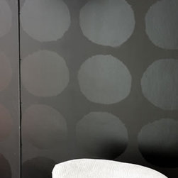 Carlu Wallcovering, Noir - Upscale, graphic circles have been printed in lustrous sheen on a matt ground to dramatic effect. This contemporary wallpaper design is printed on a heavy weight vinyl ground.