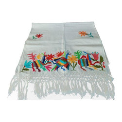 """Used White Otomi Embroidered Table Runner - Mexican Otomi handwoven work is produced mainly in San Pablito, Puebla and in a small town called Tenango de Doria, in the state of Hidalgo, Mexico. The handwoven cloth with hand-dyed cotton embroidery typically features chickens, rabbits, horses or dogs combined with frets that resemble poinsettia petals, but in bright yellow, red, green and blue.     This particular table runner is in soft white fabric and features a whimsical pattern of animals and flowers embroidered in vibrant colors on each end. It measures: 77""""(L) x 21""""(W)."""