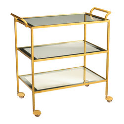 Kathy Kuo Home - Milford Hollywood Regency Glass Gold Leaf Serving Bar Cart - Roll out the royal treatment for your guests on this gorgeous, gilded bar cart. With three rectangular glass shelves, the serving cart holds an abundance of happy hour offerings and after dinner cordials. Four casters create mobility for graceful service at all your gatherings.