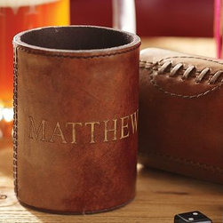 "Leather Football Bottle Cooler - Keep holiday brews chilled with our fully insulated leather coolers. A great gift for the sports fans on your list, each features stitching reminiscent of that on a football. 3"" diameter, 4"" high Made of PVC covered in leather, with polysuede lining and dyed-to-match stitching. Monogramming is available at an additional charge. Monogram will be centered on the side of the cooler. Use to keep your canned or bottled beer cool. Catalog / Internet only."