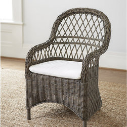 Ballard Designs - Brooke Dining Chair - Use indoors or in covered outdoor spaces. Includes Off-White cotton twill cushion. With its graceful curves and organic texture, our Brooke Dining Chair softens the linear look of tables and consoles for great natural contrast. Hand woven of wicker over a rattan frame and hand finished in a warm kubu gray wash. Finish is achieved by soaking the rattan strands in mud, then sun-drying them before weaving.Brooke Dining Chair features:. .
