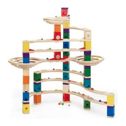 HaPe The Challenger - Create and re-create endless Quadrilla marble runs with the HaPe E6016 The Challenger. Well-made and durable, this set includes a challenging set of straight and curved rails, high-velocity tunnels, a seesaw, accelerators, blocks, levelers, bases, and 50 marbles so your child can make the most challenging runs possible. Recommended for children ages four and up. About Hape InternationalDrawing on decades of child development expertise, Hape (pronounced hah-pay) International is sensitive to children's needs whenever they develop and design a new toy. Their toys support children throughout every stage of development. This support starts at a very young age to help nurture and develop their natural abilities. Hape International's first priority is to encourage children in their individual development through building their self esteem. With their high-quality toys and games, they support children as they play, learn, interact and grow. Hape understands that children's social, emotional, intellectual and physical health is a key issue, not only for parents but also for a healthy society. That's why they take this responsibility very seriously and conduct a wide range of toy safety tests. The result is safe, exciting, stimulating toys.
