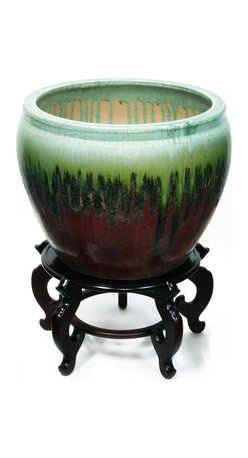 China Furniture and Arts - 19in Hand-Painted Ceramic Fishbowl Planter - Once used as bowls to keep prized Koi and other garden fish indoors during the winter months, they have now adopted their modern role as stylish cachepots for our indoor plants. Today's celadon wares are a descendant of the time-honored art form developed in China in the 10th century. An earthy red glaze and darkening color gradient at the bottom gives this particular pot a very dramatic look. Stand is sold separately.