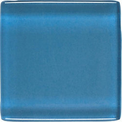 """Legacy Glass in Wedgewood - Nothing says style and sophistication quite like colored glass tiles. Available in a multitude of colors, Legacy Glass boasts a rare look that is equally at home in both contemporary and Old World settings. From 1"""" x 1"""" squares to 2"""" x 4"""" brick joints, this stunning tile features a truly unique array of sizes and colors. And while at first glance, it may seem as if this tile is suited ideally for today's contemporary designs, don't be quick to discount its use in perhaps more unexpected applications."""