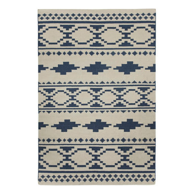 """Tribe rug in Bokrum Blue - """"Indigenous pattern when dissected is almost the exact same throughout the world. When broken down to it's most basic elements, these forms show up everywhere from Uzbekistan to the Great Plains. We wanted to create a pattern that mixed a number of these common shapes to create something new."""" - Genevieve Gorder"""