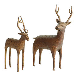 WORLDLY REINDEER STATUETTES - NEW - Cast the holiday season right into your home décor. This set of statuettes are embossed with a tribal-inspired pattern—immaculate detail that is better seen up close—that won the hearts of the Wisteria staff at first glance. Handmade with an organic, textural touch, these reindeer are a perfect centerpiece for your table setting or a lively addition to your existing seasonal décor on an entryway console. This set will deliver the gift of the holiday this year and many years to come.