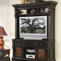 Hooker Furniture - Telluride TV Console w Hutch - Two-piece set includes LCD TV stand and hutch. Traditionally styled with fluted pilasters, crown moldings and raised framing. Wood construction with distressed black finish. Three drawers on stand plus two doors with carved leather panels and nail head trim. Hutch:. Three top compartments. Lights controlled by a three-intensity touch switch. Wiring access. Back panel in TV area can be moved forward. Accommodates most 50 in. and some 60 in. Plasma/DLP/LCD TV's. TV opening: 61 in. W x 40 in. H. Overall: 76 in. W x 20 in. D x 58 in. H (134 lbs.)Console:. Two wrap around outside doors. One adjustable shelf behind each door. Open center section with one adjustable shelf. Two outside drawers with removable CD/DVD partitions. Center drawer with drop-front. Ventilation holes. Three electrical outlets. Levelers. Finished top. Accommodates most 60 in. monitors.  71 in. W x 24.5 in. D x 36 in. H (134 lbs.). Carved leather. Nailhead trim. Made from hardwood solids and veneers. Black paint finish with rub-through and physical distressing