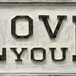 """Sugarboo Designs - Love You Wooden Sign - Handmade vintage sign with the message """"Love You"""" in carved raised lettering.  This 36"""" x 18"""" vintage wood sign adds a touch of love and care to a bedroom, kitchen, or office. This decor piece offers a thoughtful message to share with your own family. It is also a loving housewarming present for a dear friend, son or daughter, or other family member to bring well wishes to their home. The sign is available in White. It is easy to hang as wall art. The sign also creates a captured moment when placed on a desk or counter for a more casual feel. The artist mixes rustic materials with an updated, clean style to create a piece of decor art that adds charming character to your home.  Each sign is made upon customer order in the artist's Georgia-based studio using a specialized technique that paints directly onto the wood rather than using canvas.   About the Artist: Rebecca Puig is the artist behind Sugarboo Designs. Sugarboo is a family business that Rebecca and her husband, Rick, started in 2005. The name """"Sugarboo"""" came from a couple of nicknames she has for her children, Jake and Sophie. They are the main inspiration for Sugarboo because Rebecca always wants to create products that remind us of the ones we love. As a little girl, Rebecca loved to paint and create things. She attended the University of Georgia graduating with a Studio Art degree. Rebecca is inspired by her family, nature, animals, old things, childrens' art and folk art. She also loves juxtaposing old and new, light and dark, serious subject matter with fluff and anything with a message. Rebecca believes in putting good out into the world whenever possible. Her hope is that each Sugarboo piece she creates will add a little good into the world.   Product Details:"""