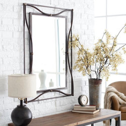 Uttermost - Thierry Iron Beveled Mirror - 28W x 38H in. - 11547 B - Shop for Mirrors from Hayneedle.com! Curving lines and accent beading adds detail to the Thierry Mirror. The result is a butterfly outline in metal which provides fluidity to the piece. The frame of this beveled mirror features a scratched bronze finish with champagne silver leaf accents. It measures 28W x 38H inches which is the perfect size for dressing up an entryway or brightening a hallway.Here's what you need to know to hang your new Uttermost Mirror. Hanging a mirror even if it is a large heavy piece is not a problem if you have the right hanging hardware and a hammer. The best hanging hardware for most walls is the J-hook. It is designed to keep the nail that goes into the wall at a sharp angle so that even in drywall it will stay in place. It is important that the J-hook be properly weighted for the item you want to hang. On all Uttermost products the proper J-hook and nails are included to make sure you have exactly the hardware you need for hanging each piece. On the largest Uttermost mirrors we provide a self-leveling adjustable J-hook. With this hardware even if the item is slightly uneven the hangers can be adjusted without moving the nails from the wall.About UttermostThe mission of the Uttermost Company is simple: to make great home accessories at reasonable prices. This has been their objective since founding their family-owned business over 30 years ago. Uttermost manufactures mirrors art metal wall art lamps accessories clocks and lighting fixtures in its Rocky Mount Virginia factories. They provide quality furnishings throughout the world from their state-of-the-art distribution center located on the West Coast of the United States.