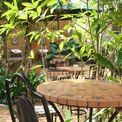 Mosaic table made in Vietnam for garden and patio - Mosaic table and wrought iron chair made by Triquimex, manufacturer of garden furniture from Vietnam.