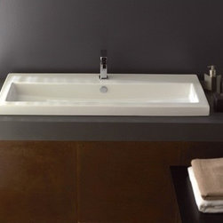 Tecla - Rectangular White Ceramic Self Rimming, Wall Mounted or Vessel Bathroom Sink - Rectangular white ceramic self rimming, wall mounted, or vessel sink. Washbasin comes with overflow and no hole, one hole, two hole, or three hole options. Made in Italy by Tecla. Made out of white ceramic. Contemporary design. Includes overflow. ADA compliant. Standard drain size of 1.25 inches. Because the sink has multiple installations, the back side is not glazed.