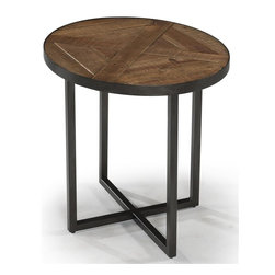 Magnussen Furniture - Lakeside Wood Oval End Table - Constructed from Reclaimed wood, Metal Tube Bases and Levelers. All pieces feature a slab-panel design. All pieces have metal tube legs under reclaimed wood. Country Styling. Natural Sienna Finish. Reclaimed wood, Metal tubing and Levelers. Natural Sienna Finish. 1 Year Limited Warranty. 26 in. W x 22 in. D x 24 in. H (28 lbs.)Straightforward in design, each slab-panel design of the Lakeside collection relies on reclaimed solid timbers recycled from old buildings and metal rod-and-tube construction to make its own subtle statement. In Natural Sienna and oxidized metal the materials has a natural patina with nail holes, dips, natural imperfections and blemishes that create unique individual character.
