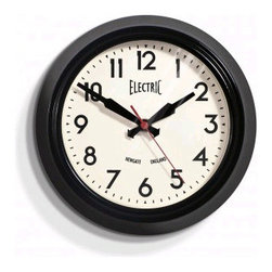 """Origin Crafts - Newgate small ?electric? wall clock - black 8"""" - Small ?Electric? Wall Clock - Black Metal case in gloss black, red or chrome plate finish, glass lens, clean modern dial, battery operated. Dimensions (in):8�? x 8�? x 3? By Newgate Clocks - Newgate specialises in the creation of iconic alarm clocks, travel alarm clocks, mantel clocks and"""