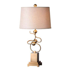 Uttermost Apollonia Modern Brass Lamp - Hand forged metal finished in a plated brushed brass. Hand forged metal finished in a plated brushed brass. The tapered oval hardback shade is a rust beige linen fabric.