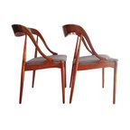 Pre-owned Danish Modern Dining Chairs by Johannes Andersen - A pair of 1950s Danish Modern dining chairs designed by Johannes Andersen for Uldum Mobelfabrik. The chairs have gorgeous, sexy lines lending comfort and style. They have black and white woven fabric seats. The chairs are in very good condition, sturdy with minimal wear for age.