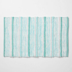 Ocean Ikat Bathmat - Anthropologie.com - Wash your tiles in hues reminiscent of the great, wide sea.