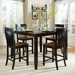None - Canterbury Dining Table - This 53-inch dining table features a two-tone finish with a brown top and black base featuring tapered legs. A self-storing butterfly mechanism with metal hinges and magnetic latches makes adjusting the size of the table a snap.