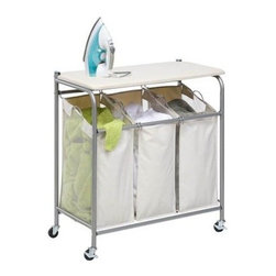 Honey Can Do - Honey-Can-Do Rolling Ironing and Sorter Combo Laundry Center - This dual purpose laundry station features a built in ironing board that lifts ups easily to expose a full-featured triple sorter below. The thick foam pad and heat resistant, 100% cotton cover provide a smooth ironing surface every time. The sorter boasts three removable polyester bags, which make for simple sorting and convenient carrying and washing. The laundry bags incorporate mesh sides for ventilation and an interior coating to resist mildew and odors. Rolling casters with locking wheels allow you to move the laundry center from washing machine to ironing space quickly and easily.