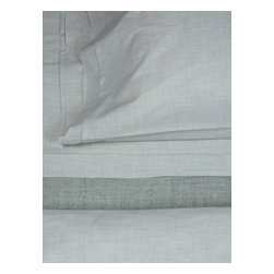 Area Inc. - Heather Cement Full/Queen Flat Sheet - Area Inc. - Minimal detail and a neutral color give the Heather Cement Full/Queen Flat Sheet its soft, simple look. Made from heathered gray yarns woven into cotton percale, this sheet features subtle pleat details for added texture. Pair it with the Heather Cement Duvet Cover for a clean, monochromatic look.