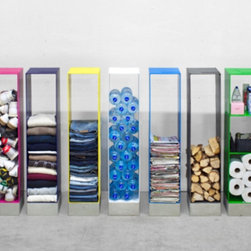 Manhattan Cabinet - This photo explains it all — the Manhattan Cabinet really is a storage catchall. I love that it comes in a rainbow of colors and if I were cool enough I really would line up a storage spectrum, as shown.