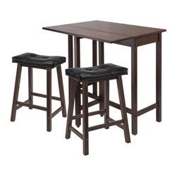 "Winsome Wood - Winsome Wood Lynnwood 3 Piece Drop Leaf Kitchen Table w/ 2 Cushion Saddle Seat S - 3 Piece Drop Leaf Kitchen Table w/ 2 Cushion Saddle Seat Stools belongs to Lynnwood Collection by Winsome Wood The set 3pcThis versatile high table is space saving and functional. A leaf is folded down for space saving and when in use lift up the leaf for an extension of top surface. Top table area when leaf is up 39.37""W x 30""D x 35.43""H. Table when leaf is folded 39.37""W x 20.70""D x 35.43""H. Drop leaf 39.37""W x 10.31""D. Constructed in solid wood in warm Antique Walnut Finish. Ready to Assemble. Pub Table (1), Stool (2)"