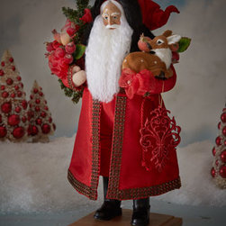 """Lynn Haney - Lynn Haney """"Festive Splendor"""" Santa - This Santa spreads goodwill and cheer wherever he goes, from his handsome red silk costume and full white beard to his shiny black boots on a stately wood base. In his arms he holds a decorative tree and a sweet fawn. Signed by artist Lynn Haney. Ori..."""