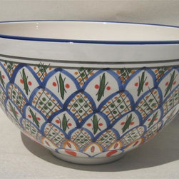 Le Souk Ceramique - Tabarka Deep Salad Bowl - 12 in. wide. 6 in. deep. Dishwasher safe . Microwave safe . Made in Tunisia. Lead free glazes . Meets CA Prop 65 . Meets all Federal StandardsNamed in part for the beautiful Tunisian seaside resort town of Tabarka where the red tile roofs of the Mediterranean beach bungalows dot the coastline, our Tabarka pattern is an elaborate blend of Italian, French and Arabic styles that throughout history have also shaped it's namesake city. Shades of fire red, goldenrod, grass green and cobalt blue are set against a white background creating a sumptuous and vibrant pattern perfect for any occasion.