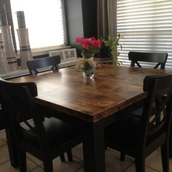 Kitchen Furniture - Here is an example of our very popular Plano style. This particular table is 45 in. square, and showcases our custom American Vintage finish on the tabletop, black painted base & legs, and semi-gloss polyurethane.