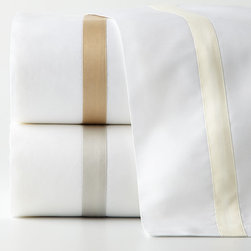 Matouk - King Lowell Flat Sheet - IVORY (KING FLAT) - MatoukKing Lowell Flat SheetDesigner About Matouk:The son of a jeweler John Matouk understood the principles of fine workmanship and quality materials. After studying fine fabrics in Italy he founded Matouk in 1929 as a source for fine bed and bath linens. Today the third generation of the Matouk family guides the company whose headquarters were relocated to the United States from Europe during World War II. Matouk linens are prized worldwide for their uncompromising quality and hand-finished detailing by skilled craftsmen.